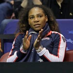 USA's Serena Williams cheers on Venus Williams against Netherlands' Arantxa Rus during a match in the first round of Fed Cup tennis competition in Asheville, N.C., Saturday, Feb. 10, 2018. (AP Photo/Chuck Burton) ORG XMIT: NCCB112