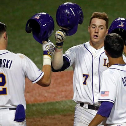 LSU's Greg Deichmann (7) is greeted as at the plate