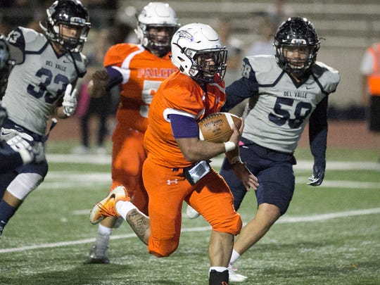 Eastlake running back Adrian Chavez, 8, steams to the goal line for a score against Del Valle Friday night.