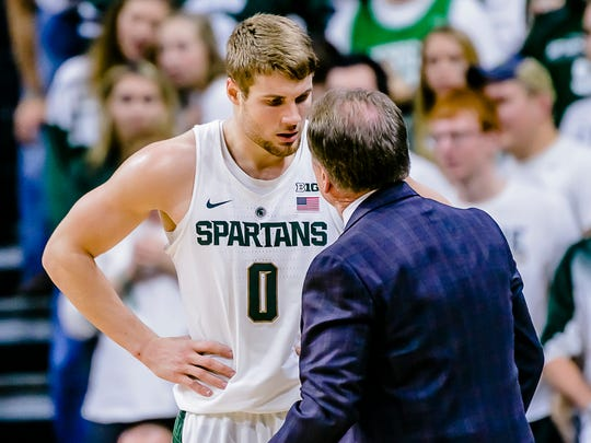 MSU's Kyle Ahrens listens as coach Tom Izzo gives him an ear full during their game with Tennessee Tech Saturday. Ahrens, playing out of position at power forward, tallied nine points and seven rebounds in 27 minutes.