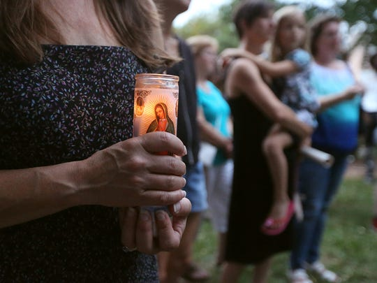 Stacy Palmer holds a candle during a candlelight vigil and peace rally held at the steps of the Rutherford County Courthouse, in Murfreesboro, on Sunday, Aug. 13 ,2017, in response to recent violent events in Charlottesville, Virginia, on Saturday.