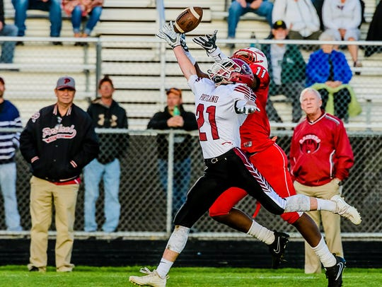 Gavin Dennany of Portland breaks up a pass meant for