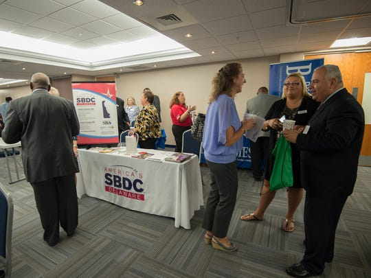 Attendees visit the different businesses at the ninth annual Kent County Economic Summit at Delaware Technical Community College in Dover.