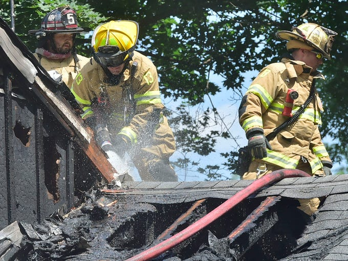 Firefighters are on the roof at a house fire Wednesday,