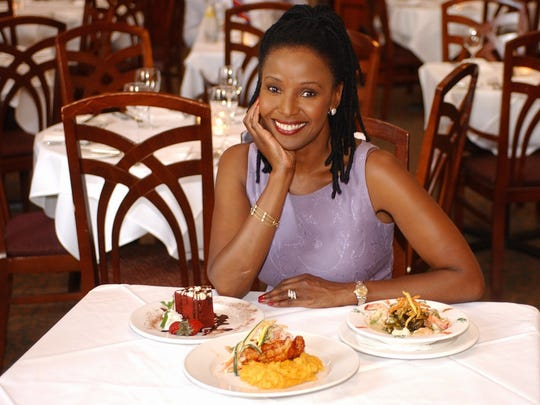 Barbara Smith shows off some of the dishes at her Washington restaurant, B. Smith's, on July 10, 2002. Barbara Smith, known as B. Smith, is a black model and entertainer, whose appeal has crossed ethnic lines.