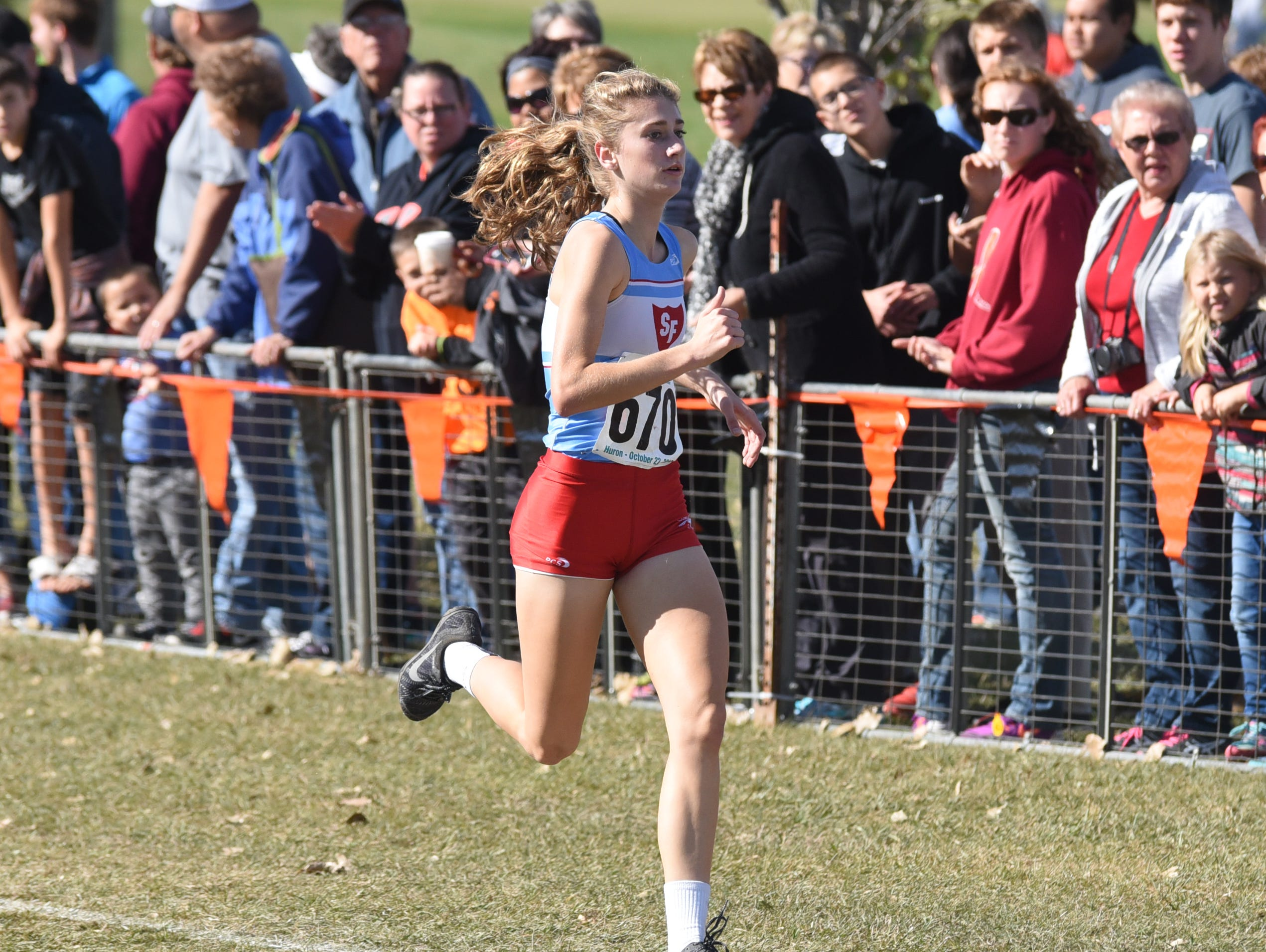 Sioux Falls Lincoln junior Courtney Klatt races toward the finish line in the Class AA girls' race at the South Dakota State Cross Country Meet in Saturday in Huron. Klatt won the race, helping the Patriots to the team title.