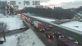 I-83 north is backed up near exit 22 (North George Street) as PennDOT continues to clear snow from the shoulder.