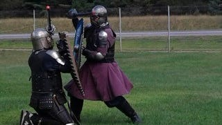 Knights of the Society for Creative Anachronism re-enact medieval fighting techniques.