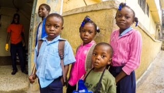 Orphans at the church of Bible Understanding Orphanage eagerly await the arrival of Passion Rescue Mission members.