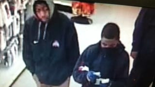 Detroit Police released photos of suspects sought in several dollar store robberies.