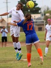 Alamogordo freshman Shawna Williams, left, tries to win possession of a ball over Los Lunas freshman Haley Enriquez.