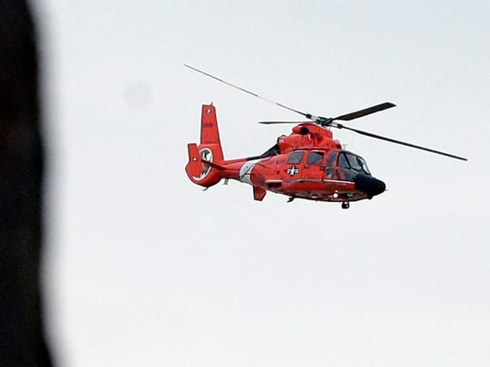 A Coast Guard helicopter from Traverse City, Mich., hovers over a mock disaster scene in Lake Michigan at Milwaukee's McKinley Marina in this file photo.