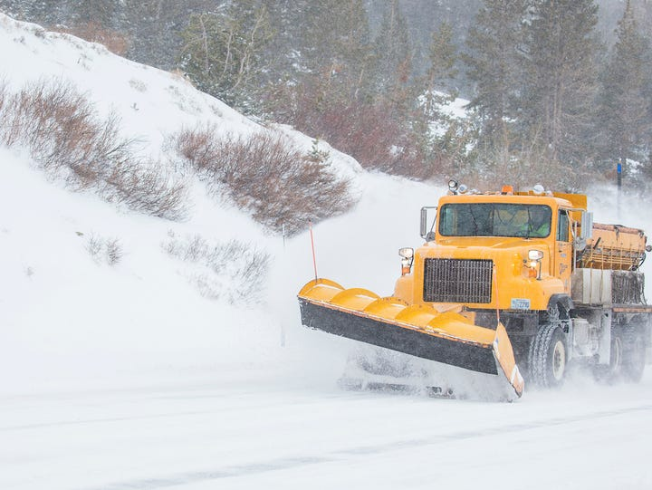 A snow plow works near the summit of the Mt. Rose Highway