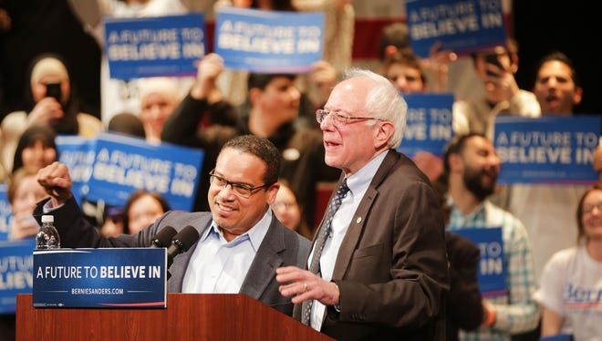 Detroit native Congressman Keith Ellison, a U.S. Representative from Minnesota, left, introduces presidential candidate Bernie Sanders  to a crowd of supporters at the Michael A. Guido Theater in Dearborn  Monday, March 7, 2016. Regina H. Boone/Detroit Free Press