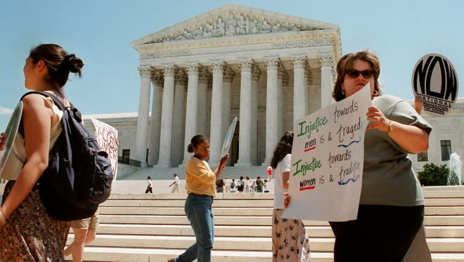 Demonstrators supporting 7-1 Supreme Court ruling on June 26, 1996 that all-male VMI must admit women or give up state funds. Scalia was the lone dissent.