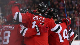 The New Jersey Devils celebrate a goal by center Brian Boyle (11) against the Vancouver Canucks during the second period at Prudential Center on Friday, Nov. 24, 2017.
