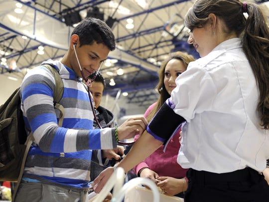 Piedra Vista High School's Alejandro Contreras checks