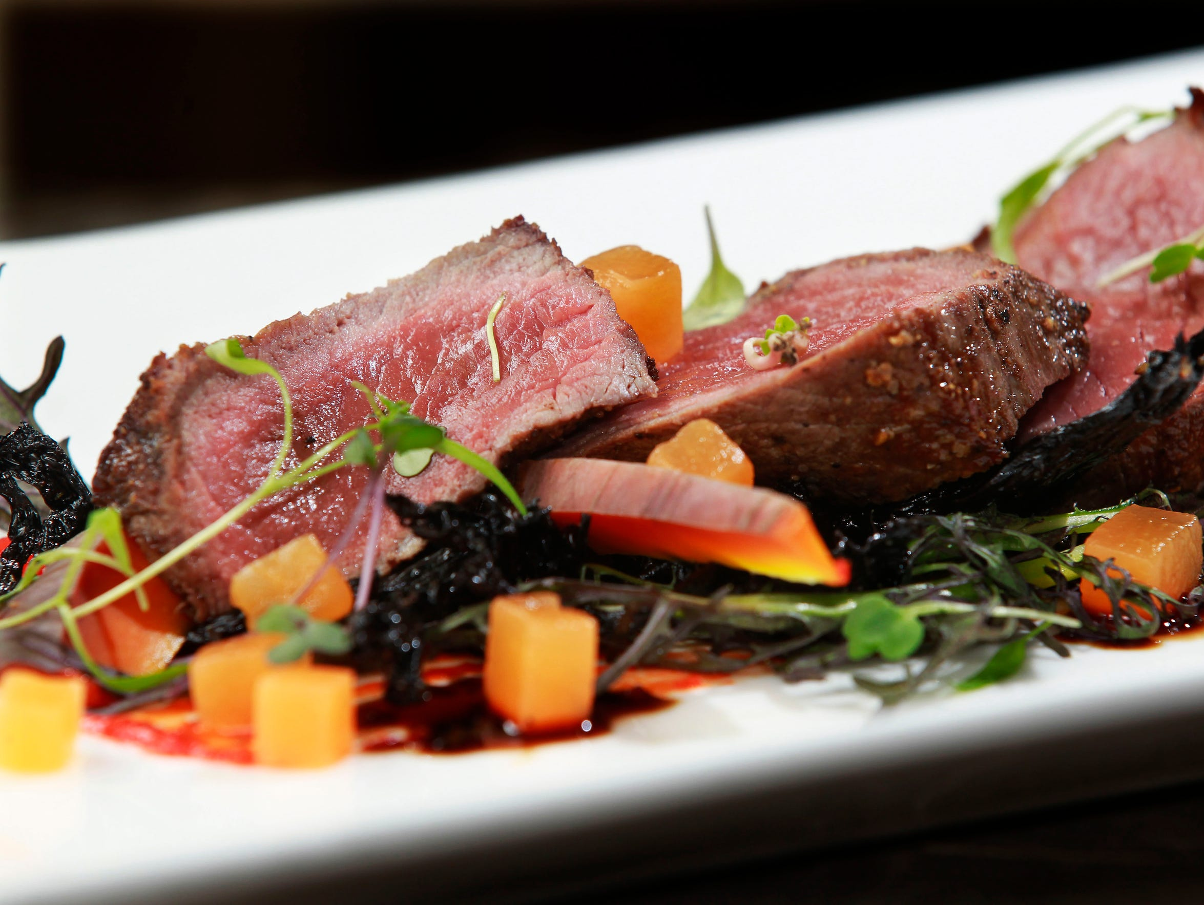 Wood fire grilled antelope with mizuna, black trumpet