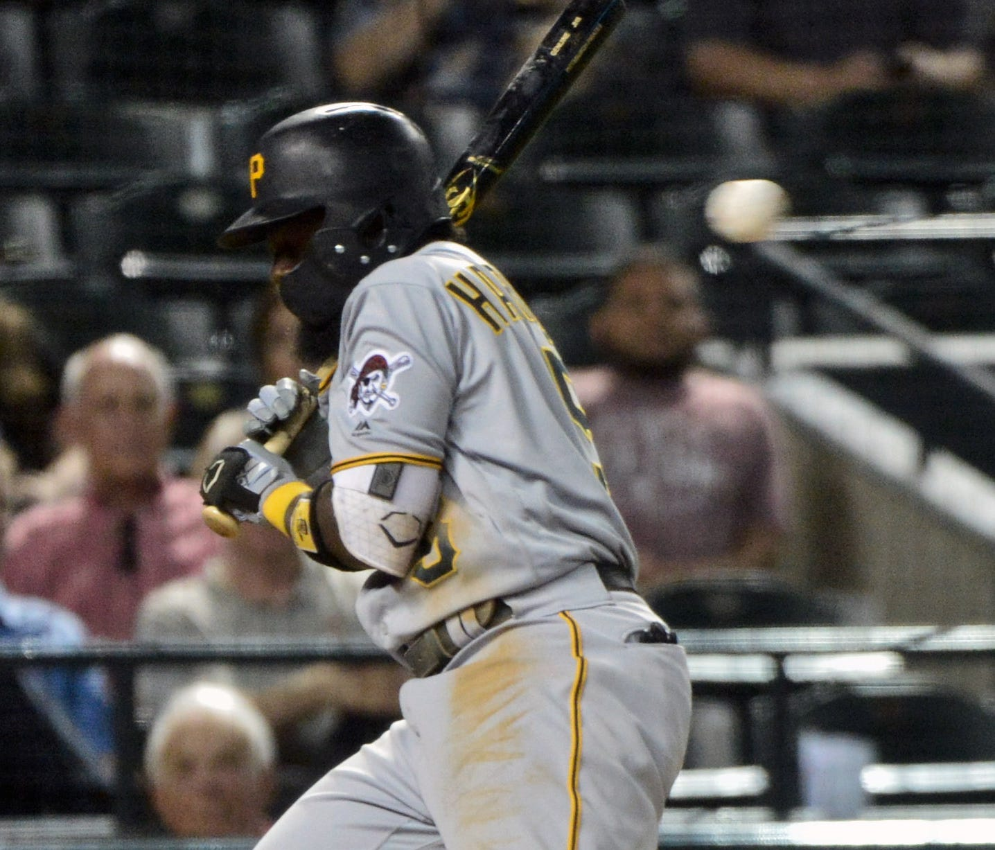 Pirates' Josh Harrison is hit by a pitch in the seventh inning.