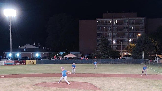 The Soo Sluggers set up their defense under the lights during a tournament at West Branch over the weekend. The Sluggers U-11 team went 2-1 at the tourney.