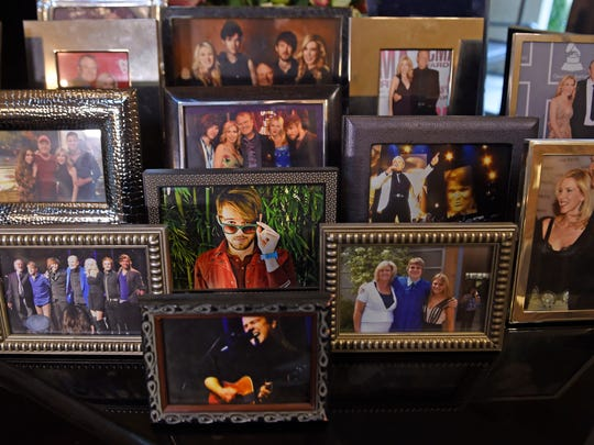 Family photos sit on the piano inside country music