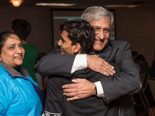 Dr. Anil Kumar greets nephew Jay Kostecke, and Kumar's