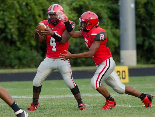 Quarterback Terrence Ealy fakes the handoff to Dion