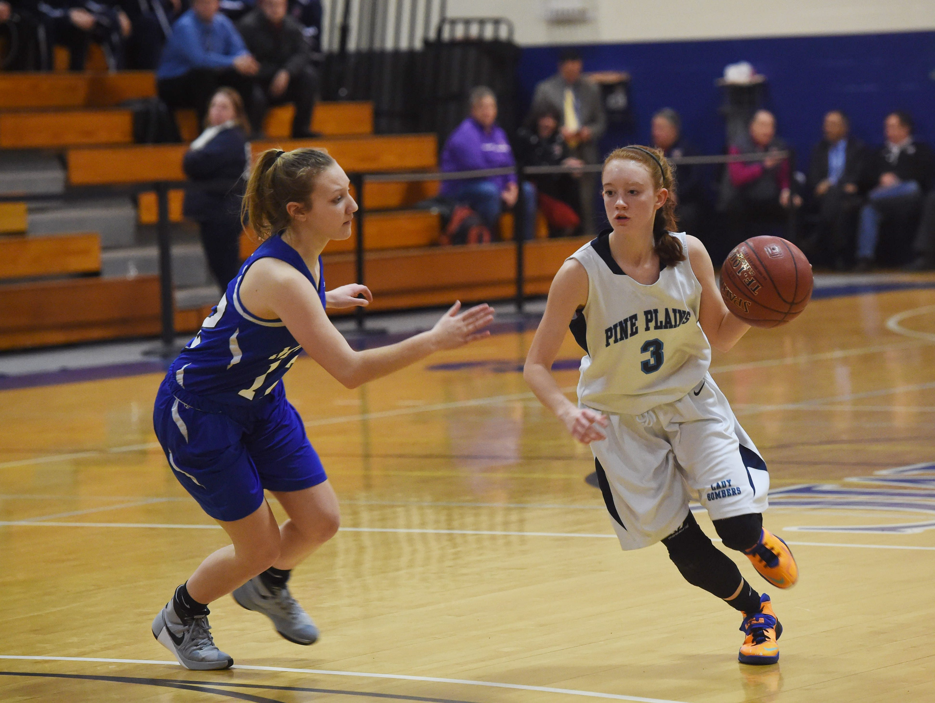 Pine Plains' Frances Snyder, right, takes the ball down the court during Friday's Section 9 championship game against Millbrook at Mount Saint Mary College in Newburgh.