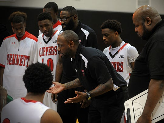 Andre Collins talks to his players during a timeout