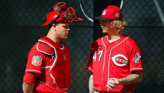 Cincinnati Reds catcher Devin Mesoraco (39), left, talks with Cincinnati Reds pitcher John Lamb (47), right, following Lamb's bullpen session at Cincinnati Reds spring training, Sunday, Feb. 21, 2016, in Goodyear, Arizona.