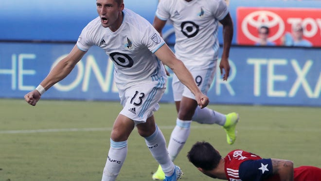 Minnesota United's Ethan Finlay (13) and Angelo Rodriguez, left rear, celebrate Finlay's goal against FC Dallas in the first half of an MLS soccer match in Frisco, Texas, Saturday, Aug. 10, 2019.