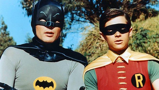 "Adam West (left) as Batman and Burt Ward as Robin in the 1966 movie ""Batman."""