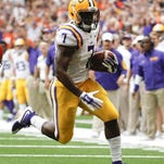 LSU running back Leonard Fournette (7) gains yards on a run during the first half of an NCAA college football game against Syracuse on Saturday, Sept. 26, 2015, in Syracuse, N.Y. (AP Photo/Mike Groll)
