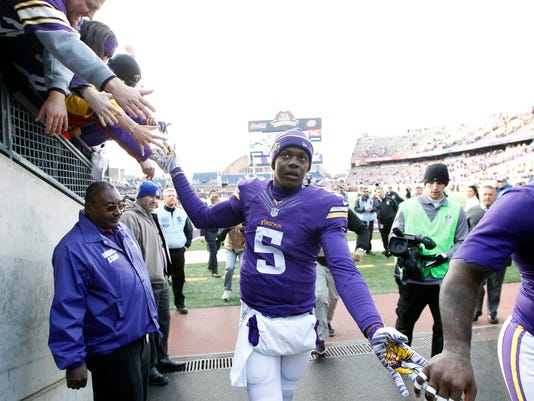 Minnesota Vikings quarterback Teddy Bridgewater celebrates with fans after an NFL football game against the Washington Redskins, Sunday, Nov. 2, 2014, in Minneapolis. The Vikings won 29-26. (AP Photo/Ann Heisenfelt)