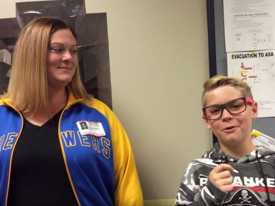 Horizon Elementary School student Charlie Rumohr (right) interviews Horizon Elementary secretary Alexis Riches for a segment of the Pirate News Crew's video news program.