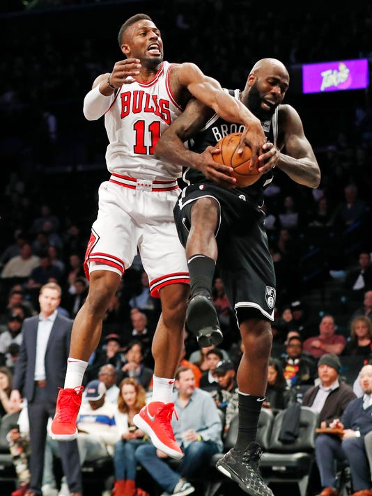 Chicago Bulls forward David Nwaba (11) struggles for the ball but Brooklyn Nets forward Quincy Acy (13) gets control of it beneath the Bulls basket during the first half of an NBA basketball game, Monday, April 9, 2018, in New York. (AP Photo/Kathy Willens)