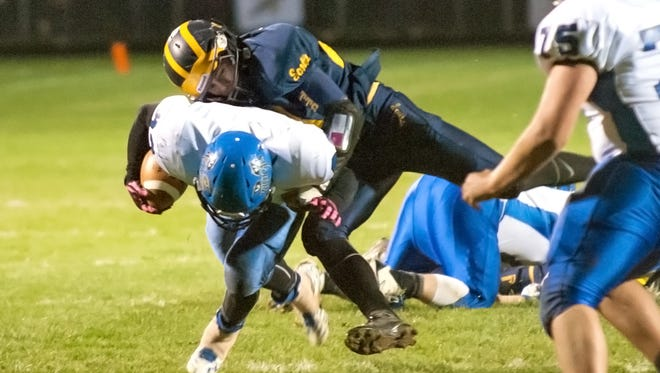 Climax-Scotts defensive tackle Zach Tullis makes a tackle against Pittsford on Friday.