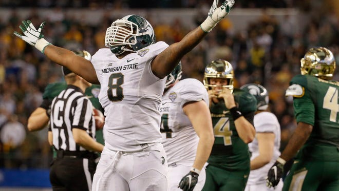 Michigan State Spartans defensive lineman Lawrence Thomas (8) reacts during the fourth quarter against the Baylor Bears in the 2015 Cotton Bowl Classic at AT&T Stadium.