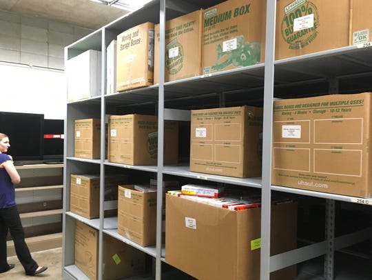 Cartons of evidence kits from rape cases line the shelves