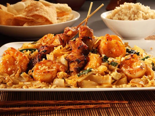 Flo's gluten-free shrimp pad thai is a classic medley of rice noodles, bean sprouts and egg topped with peanuts.