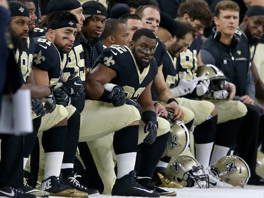 New Orleans Saints players, including running back