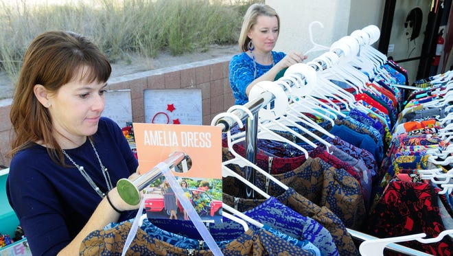 Sisters Bailey Williams, foreground, and Piper Gibson organize clothing on Wedensday as they host a Lularoe Clothing pop-up boutique at Salon A2titude.