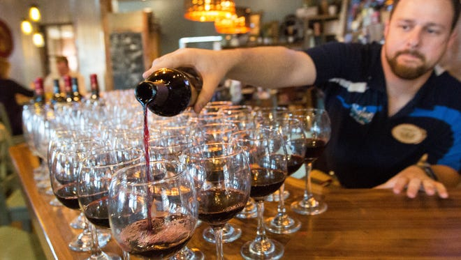 Chris Schaljo, co-owner of Salud de Mesilla pours a Malbec from Amaro Winery, for a dinner party at the restaurant in March 2018. The restaurant partnered with New Mexico State University in the fall of 2018 to give students a real-world look into restaurant operations.