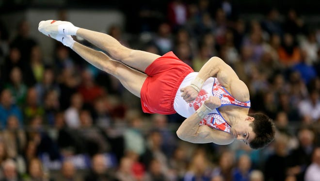 Nikolai Kuksenkov from Russia performs on the floor during the men's final at the gymnastics DTB World Cup in Stuttgart, Germany, on March 20, 2016.