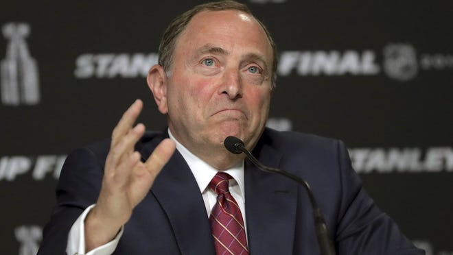 Commissioner Gary Bettman and NHL nailed down the final details of a playoff format if the season can resume on the same day word came out that another player has tested positive for the coronavirus.
