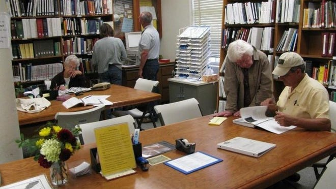 VT-FCGS volunteers assist visitors at the current Vermont Genealogy Library in Colchester.