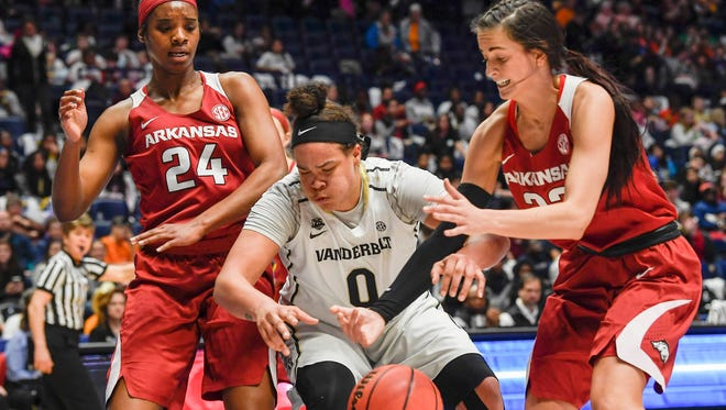 Vanderbilt forward Kayla Overbeck is fouled by Arkansas guard Bailey Zimmerman during a game in February. The Newbury Park High graduate is transferring to USC.