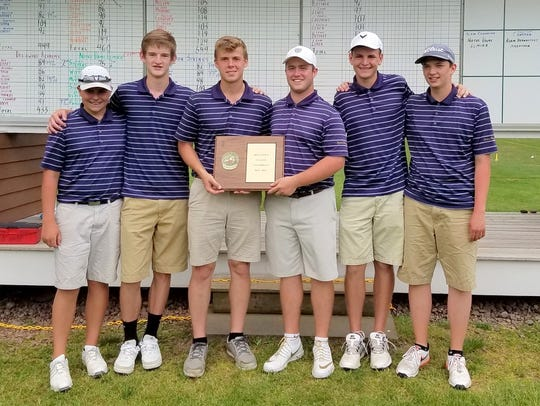 Members of the Elmira Notre Dame golf team hold their