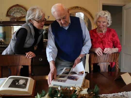 Jack and Mary Weatherford look at albums with their daughter Virginia Perry in their home in Murfreesboro on Saturday, Jan. 27.