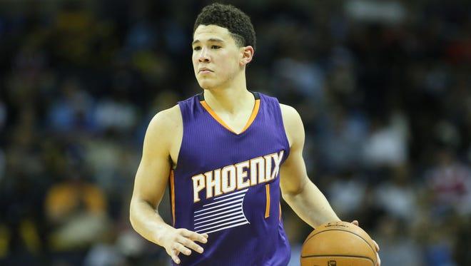 Mar 6, 2016: Suns guard Devin Booker (1) dribbles during the second half against the Memphis Grizzlies at FedExForum. Phoenix defeated Memphis 109-100.
